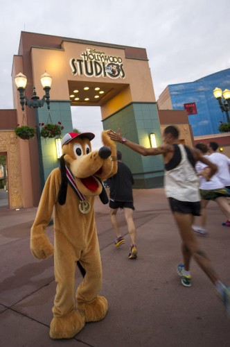 High fives with Pluto!Photo Courtesy of runDisney