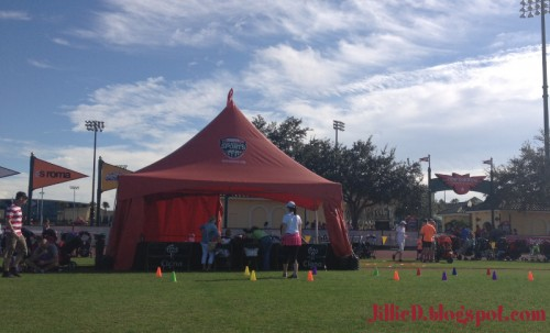 Tent with pre-race games and activities- cone racing, bean bag toss & coloring books!