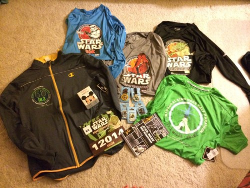 Pictured are the three race shirts that come with Rebel Challenge registration, the Rebel Challenge jacket, pins, Star Wars Half Marathon shirt, my bib, runDisney Vinylmation and the event guide. Between us, Hubby and I had quite a lot of stuff after leaving the expo.